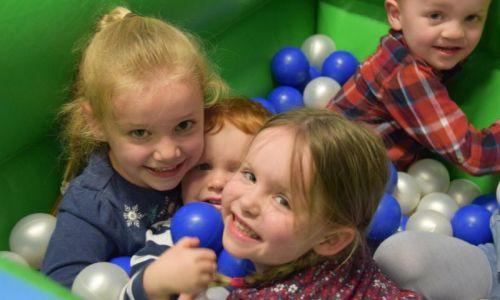 children in a ball pit